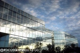 Reflection of clouds on glass building