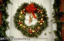 Christmas wreath and decorations on door