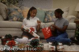 Sisters at home w/Christmas presents