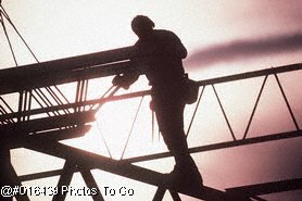 Silhouette of construction worker on site