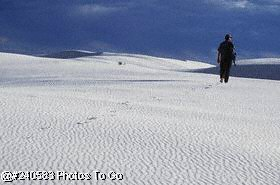 Man walking on sand dunes