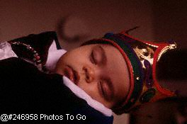 Sleeping baby in Halloween costume