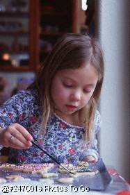 Girl decorating Christmas cookies