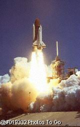 Space shuttle lifting off during launch