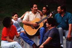 Man Playing Guitar with Family